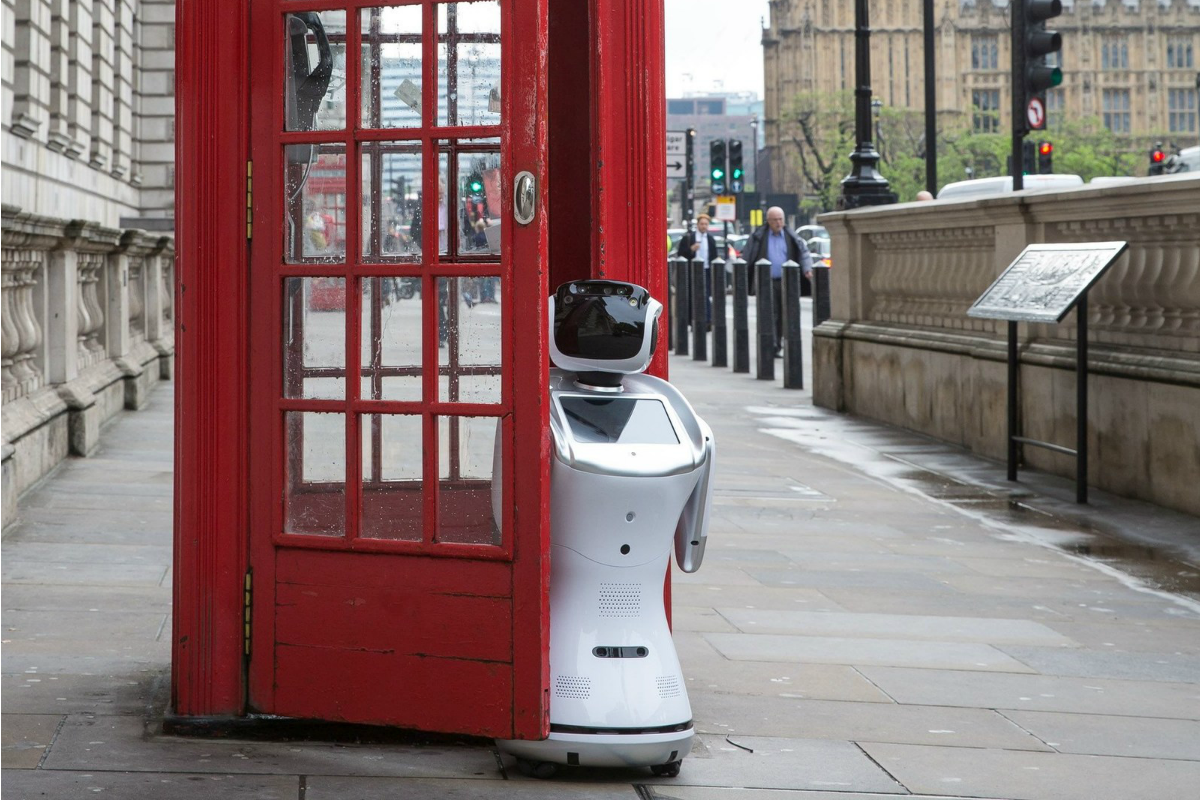 Sanbot robot poses by a phone box in front of Big Ben to promote London Tech Week