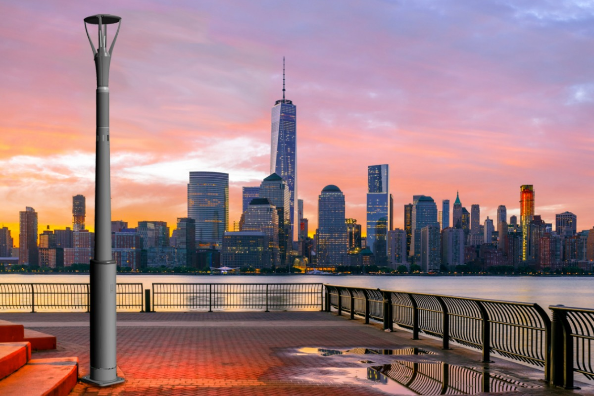 A CAD rendering of the smart pole on to an image of the New York skyline